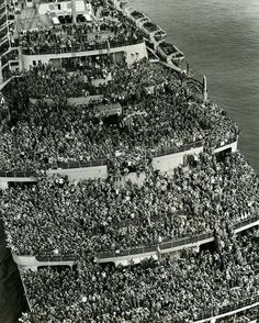 "The liner ""Queen Elizabeth"" bringing American troops into NY Harbor at the end of WW II 1945."