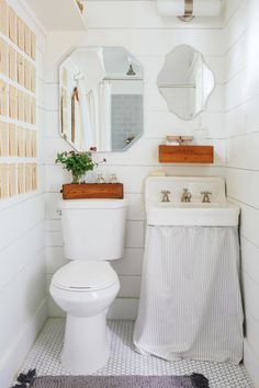 See every spot as a stylish storage opportunity — even the top of your toilet tank. | 13 Clever Tiny Apartments That Are So Freaking Inspiring