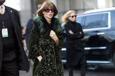 Anna Wintour bearing the cold in a green long coat with a fur collar // NYFW street style... - Street Style