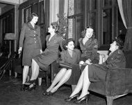 Women in Combat FILE - In this March 1947 file photo, a group of Women Army Corps (WAC) personnel pose in a Tokyo lounge. (AP Photo, File)