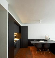 A minimalist #kitchen in an apartment in Cadaques, Spain, designed by Fracesc Rife Studio.