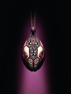 Bulgari Serpenti Seduttori pendant in rose gold, with two rubellite eyes and pavé set diamonds.
