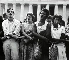 This is a picture of black and white people coming together during the civil rights movement. Not all white people treated blacks poorly and some believed in equality.