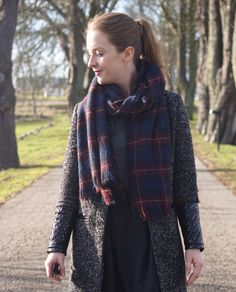 Tartan scarf and a grey coat
