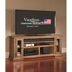 """This oak wood TV stand from Vaughan Bassett holds up to a 70"""" screen TV. Vaughan Caden 66"""" TV Stand 