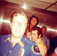 Peek-a-boo ;-) Elvis Presley and Charlie Hodge in an elevator at the International Hotel in Las Vegas, NV, August 1969