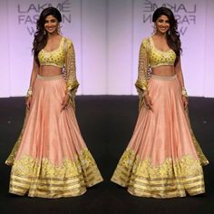 Divya Reddy's new collection is all about light shades and intricate embroidery. Shilpa Shetty mesmerized the audience in a flawless crop top lehenga at Lakme Fashion Week.