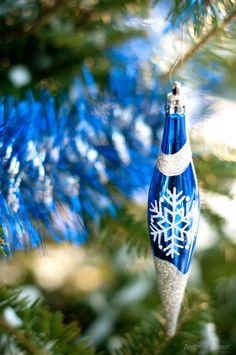 Make them yourself!! A little Elmer's and a paint brush, then roll these ornaments in sparkling glitter.   And you have your own original fun decorations for your tree!! Add the year, and you can make one new ornament each year to give your children, so when they move out they have their own starter Christmas tree decorations!! Keep making and adding each year!!