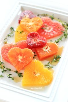 Sweetheart Citrus Salad with Cinnamon Maple Syrup ~ 4-6 pieces of citrus fruit (a variety), ¼ cup maple syrup (or more), 1 stick cinnamon. Cut citrus w/heart shaped cookie cutter. Heat cinnamon w/syrup gently for 15 minutes & drizzle over citrus! <3 #MyVeganJournal