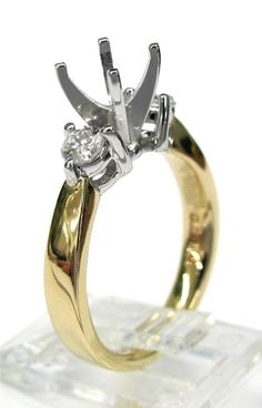 Ladies 14kt yellow gold semi mount. Mounted in ring are 2 brilliant round cut diamonds weighing a total of .37ct. Mounting is made to take any size and shape diamond in the center.