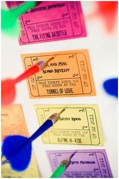Carnival ticket escort cards, by Amber Karson Events and photo by Sam Hughes