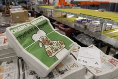 Copies of the upcoming edition of the French satirical magazine Charlie Hebdo are stacked at a distribution centre in Nantes, France, on Jan 13, 2014.