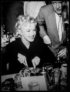 1956 / Marilyn Monroe on a break from filming Bus Stop. Eating dinner with the cast and crew at Rams, a diner in Sun Valley, Idaho.