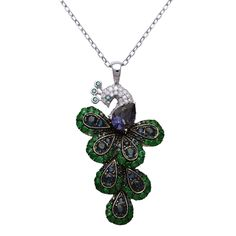 Emeralds, blue sapphires, diamonds and an iolite create a peacock shaped pendant at the end of this 14 karat white gold chain. An antiqued finish adds the perfect touch.
