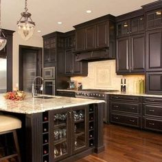 Espresso kitchen cabinets are often seen in kitchen design as this color refers to the palette of natural shades and it looks great on natural materials Dark Wood Cabinets, Dark Kitchen Cabinets, Kitchen Cabinet Design, Dark Wood Kitchens, Bright Kitchens, Villas, Repainting Kitchen Cabinets, Monochrome Interior, Modern Kitchen Interiors