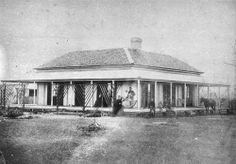 Residence of J E Noakes  Lowset house with wide verandahs and family posing at the front