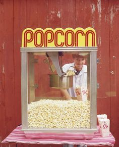 A popcorn machine will provide enough snacks for a large group and it will give your movie party an authentic movie theater feel. (Martha Stewart Living, July 2005)