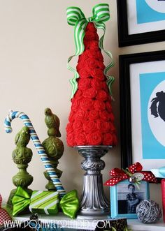 Craft a Christmas tree using crepe paper rolled rosettes and a Styrofoam cone base.