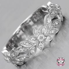 Diamond Wedding Band  from the Fay Cullen website. I love most of their wedding bands. This one almost looks like a daffodil. :)
