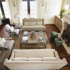 Urban Grace Interiors - living rooms - swoop arm sofa, ivory swoop arm sofa, nailhead sofa, brickmakers coffee table, sofas facing each other, face to face sofas, plaid chairs, fireplace stools, jade green stools,