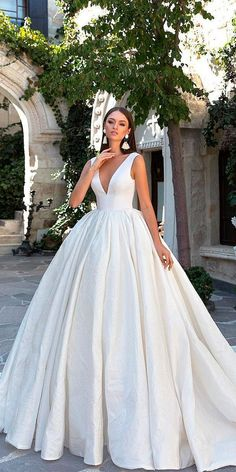 The wedding dress is filled with delicately feminine details. Which is irresistibly romantic bridal collection features elegant wedding dresses. Click the picture to see more beautiful dresses. Wedding Dress Tea Length, Wedding Dress Black, Wedding Dresses 2018, Princess Wedding Dresses, Elegant Wedding Dress, Bridal Dresses, Bridesmaid Dresses, Wedding White, Summer Wedding