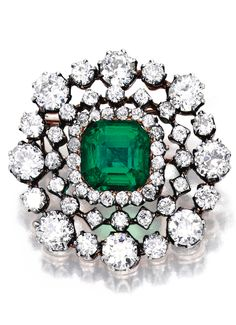 SILVER, GOLD, EMERALD AND DIAMOND BROOCH Centered by a square emerald-cut emerald weighing 5.01 carats, framed by old mine and old European-cut diamonds weighing approximately 7.15 carats; circa 1890.