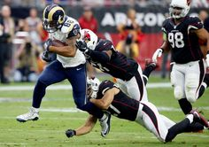 Rams vs. Cardinals Updated October 2, 2016:  17-13, Rams  -     Los Angeles Rams tight end Lance Kendricks (88) is hit by Arizona Cardinals defensive back Tyvon Branch (27) and Kevin Minter (51) during the first half of an NFL football game, Sunday, Oct. 2, 2016, in Glendale, Ariz.