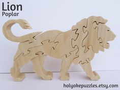 This Lion puzzle is made of poplar with a non-toxic tung oil finish. It measures approximately 7 x 4 ¼ x ¾ inches (17.8 x 11.4 x 1.9 cm). A great