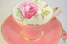 Striking pink corset Aynsley tea cup and saucer. Stunning pink corset tea cup and saucer with large pink rose transfer. Vintage item from 1934-1939 No chips, no cracks, manufacturing flaw in the paint on saucer (see photo), in very good vintage condition This item measures Width: 5
