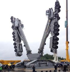 Liebherr is holding its bi-annual Customer Days in the rain today, the company always likes to show off a dramatic crane related centre piece, and this year is no exception. It has two 750 tonne LTM 1750-9.1 All Terrains locked into a crawler undercarriage to create a dynamic rotating sculpture.
