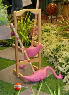 alice wonderland garden. Cute! put pink plastic flamingos on the heads of the mallets!