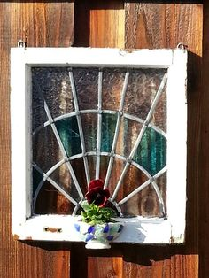 Vintage stained glass window with sea glass cup planter....cute and no cost!