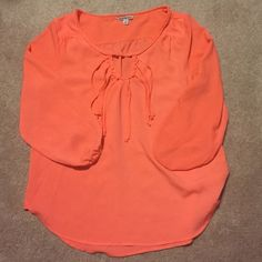 AEO chiffon top Gorgeous 3/4 sleeve American Eagle chiffon type top with keyhole and fringe. Looks super cute with crops and wedges. Perfect for spring transition! American Eagle Outfitters Tops Blouses