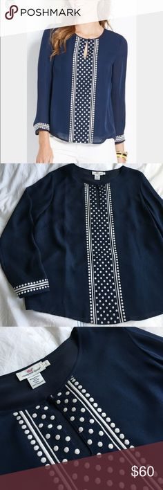 Vineyard Vines embroidered dot silk navy blouse Classic navy and white dot combo! The detail is carried to the wrists as well. EUC. 100% silk. 26 inches long. Vineyard Vines Tops Blouses