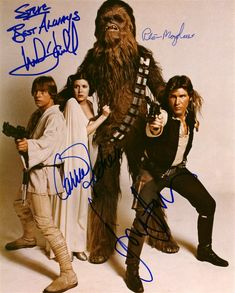 Autographed photo of Mark Hamill, Carrie Fisher, Peter Mayhew and Harrison Ford.  Man, I knew Carrie Fisher was short and that Peter Mayhew was tall, but this photo really shows how much taller the walking carpet was compared to the Princess.