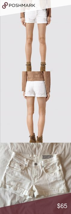 All Saints Rip Shorts in White All Saints Rip Shorts in White Size 24. Mid-rise, washed and laundered for a distressed look. Stretch denim, 92% cotton, 2% elastase. Button Front closure and cuffed bottom. A spring and summer staple! Worn once! All Saints Shorts Jean Shorts