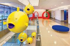 Johns Hopkins Hospital's Artful New Building - A school of puffer fish, by Robert Israel, are suspended above a stairway. Great for the pediatric facility.