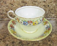 Vintage AynsLey Teacup Saucer Set ~ Anemone Poppy CoLorfuL Pattern YeLLow Background ~ Fine Bone China Made in EngLand