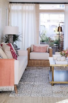I love the beachy feel of this room with the white and rattan. The stitched layered hide rug was gorgeous. See more on House Of Hipsters blog.