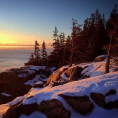 The sun rises at Otter Cliff in Acadia National Park on this January 2015 morning. (BDN photo by Brian Feulner)