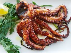 Italian-Style Grilled Octopus--Start here: http://www.italianfoodforever.com/2013/08/grilled-octopus-seriouseats-com/ .That octopus could probably do maths.