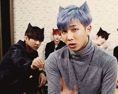 Why is V tugging on Namjoons shirt it's so cute and Jungkook in the back posing