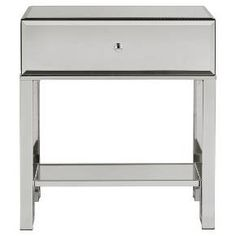 The Caminita Glam Mirrored Accent Table from Inspire Q is an easy way to give your home an elegant boost. The modern accent table comes in neutral colors so it's easy to incorporate, and is made of metal and mirror material. Be sure to add your favorite accent piece on top of this one-drawer accent table, or on the bottom shelf.