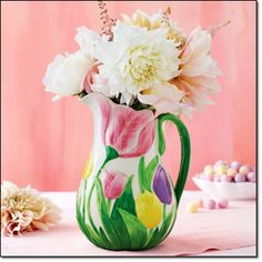 """Campaign 6 '16 www.youravon.com/hslocomb Ceramic Hand-Painted Tulip Pitcher   Pitcher features an embossed tulip design, a stem handle and a hand-painted finish. It's food-safe to serve a drink and also doubles as a vase. Hand wash only. 9"""" H. Porcelain. Imported.        Brochure:  $19.99"""