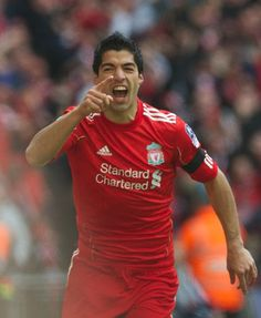Luis Suarez celebrates his Wembley goal