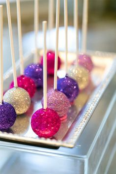 Love these purple and pink glittery cake pops for a Shimmer and Shine inspired birthday party!