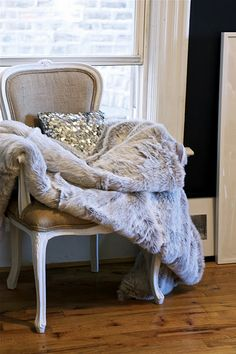 I'm totally doing this with my 2 side chairs - but with just a piece of faux fur to drape on the chair!