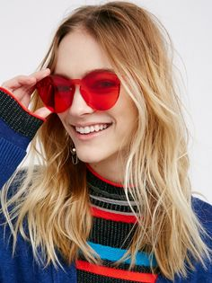 Spectrum Sunglass   Ultra cool sunnies with a modern, high fashion feel. Available in an array of hues, this accessory is a truly stylish statement piece.