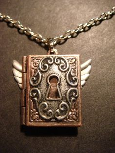 Steampunk Book Locket with Wings and Ornate Key Hole