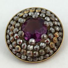 Amethyst jewel button with cut steels.